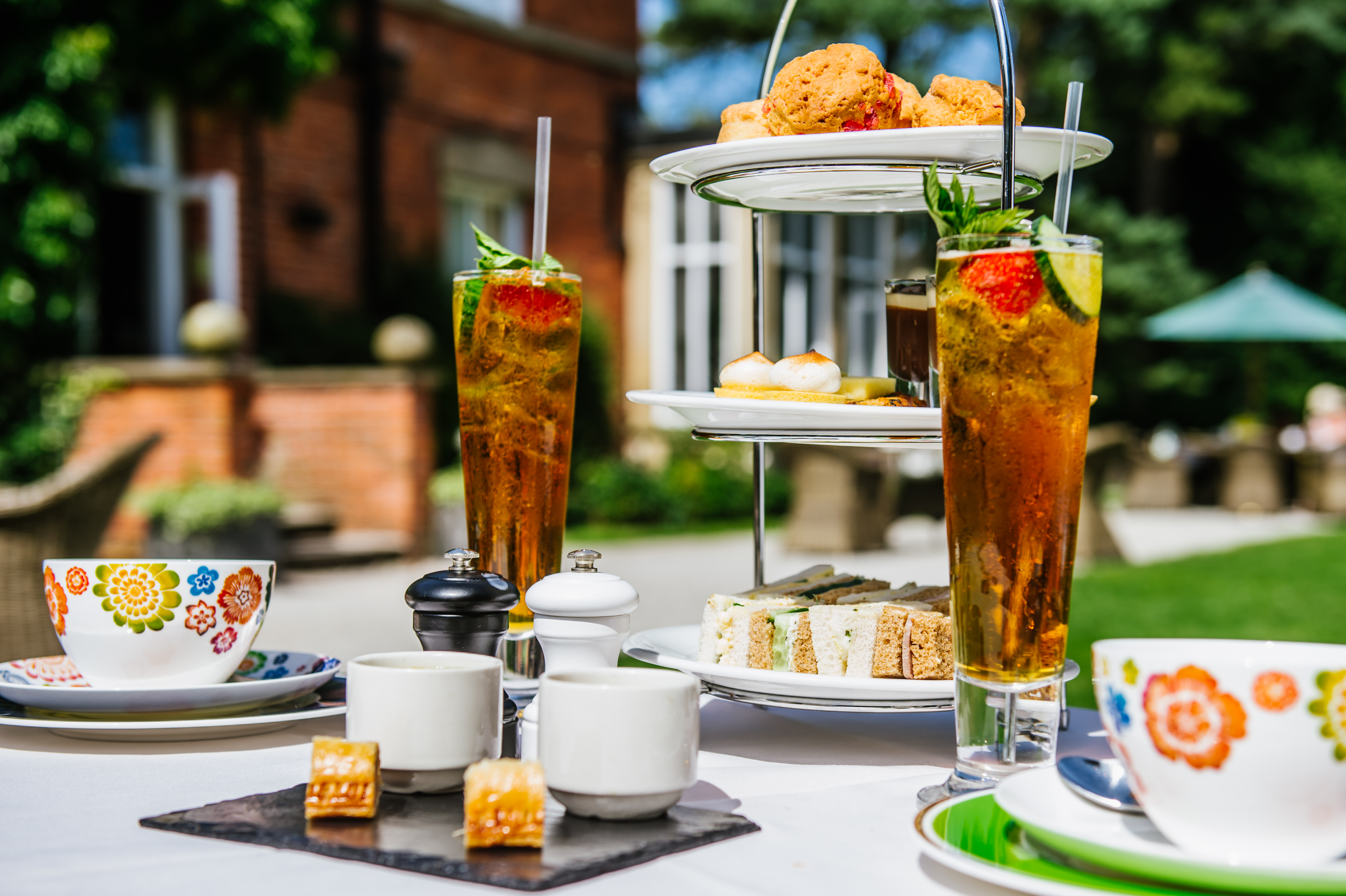 an image showing afternoon tea with cakes outside of Bartle Hall